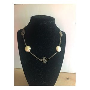 Faux gold chain with white and gold details